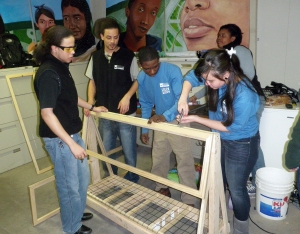 Green & Grow apprentices building their greenhouse.