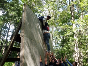 The team is shown here, hoisting Noelia over the wall obstacle.